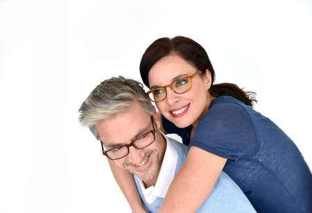 glass of: Middle-aged couple with eyeglasses on white background