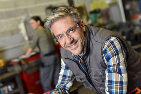metalworker: Portrait of middle-aged metalworker in workshop