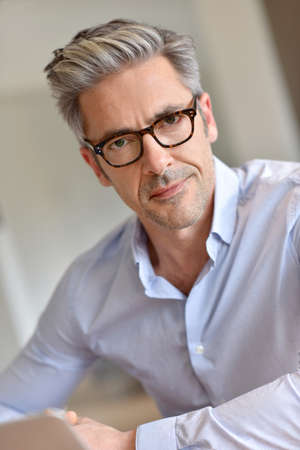 45 years old: Portrait of handsome businessman with eyeglasses