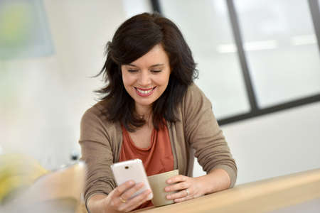 middleaged: Middle-aged woman websurfing with smartphone