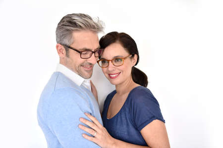 brunette woman: Middle-aged couple with eyeglasses on white background