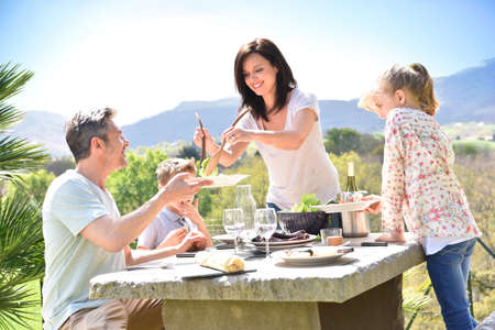 cheerful: Cheerful family having outdoor lunch