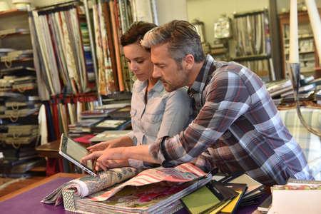 samples: People in upholstery shop choosing sample Stock Photo