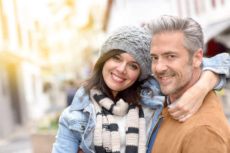 tenderness: Mature man holding girlfriend in arms Stock Photo