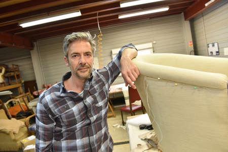 upholsterer: Portrait of successful upholsterer in workshop