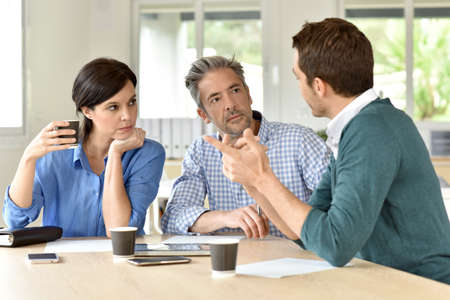 business casual: Business team gathering for meeting Stock Photo
