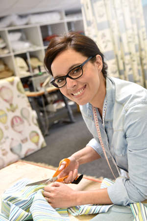 upholsterer: Seamstress woman preparing material Stock Photo