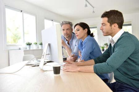 business people meeting: Business people working on desktop computer Stock Photo