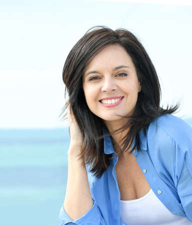 blue shirt: Portrait of attractive woman in blue shirt
