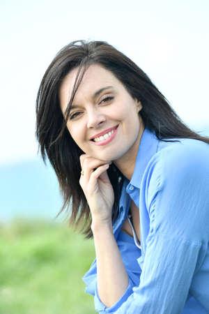 brunet: Portrait of attractive woman in blue shirt