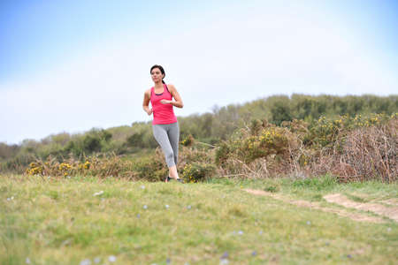 woman running: Woman running in the countryside