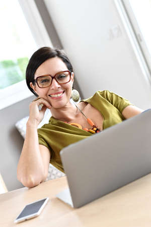 happy work: Trendy woman working on laptop from home