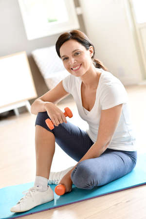 sport woman: Woman at home doing fitness exercises Stock Photo