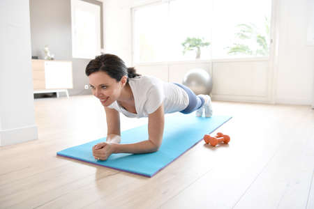 Woman doing workout exercises at home