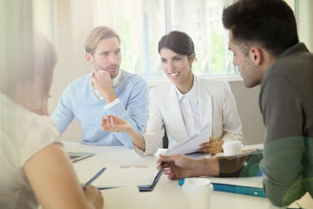 workteam: Business people meeting around table in modern space Stock Photo