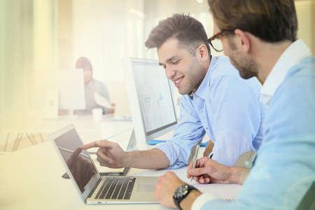 workteam: Businessmen in work meeting with laptop computer Stock Photo
