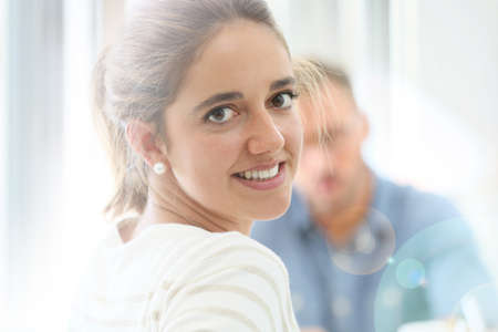 attending: Student girl attending class at university Stock Photo