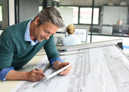 office man: Architect working on project in office