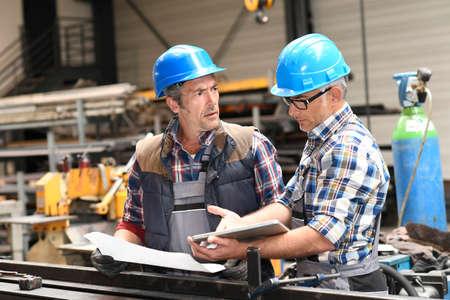 metallurgy: Engineers working on project in metallurgy workshop