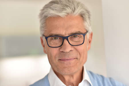 Portrait of senior man with eyeglasses