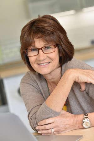 mature woman: Senior woman using laptop computer