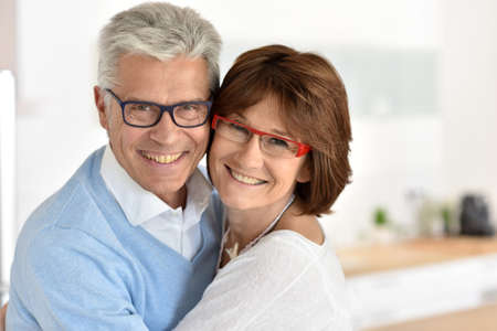 Portrait of smiling senior couple at home 스톡 콘텐츠