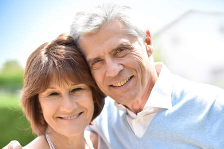 couples hug: Senior couple embracing each other outside