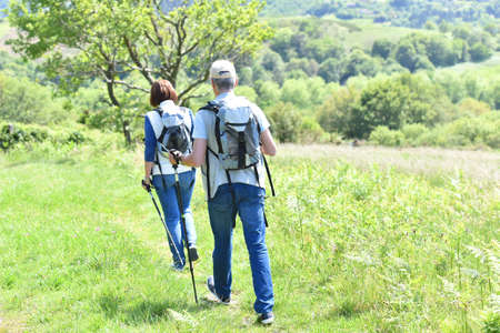 rambling: Senior couple on a hiking day in countryside