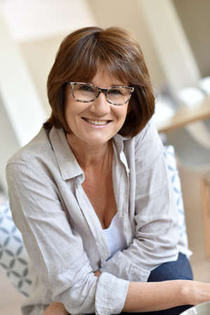 mature brunette: Portrait of smiling senior woman Stock Photo
