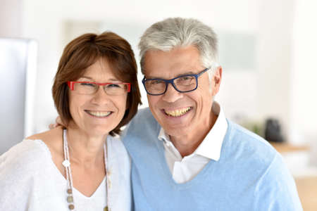senior men: Portrait of smiling senior couple at home Stock Photo