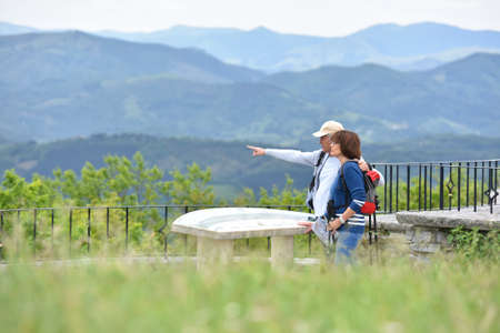 rambling: Hikers looking at orientation table from scenery point