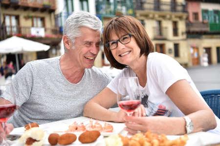 fingerfood: Senior couple eating spanish fingerfood in Spain