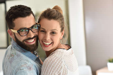 each other: Cheerful couple embracing each other