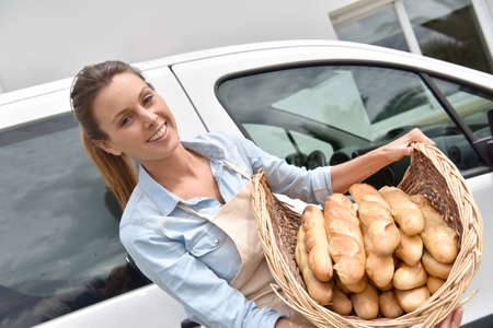 delivery van: Cheerful baker delivering bread to client