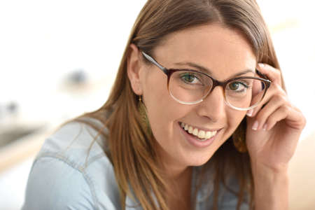 30 years old woman: Portrait of beautiful young woman with eyeglasses