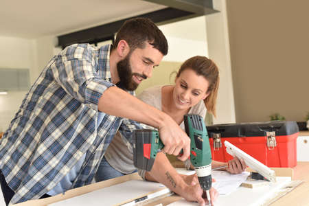 Couple assembling new furniture Stock Photo