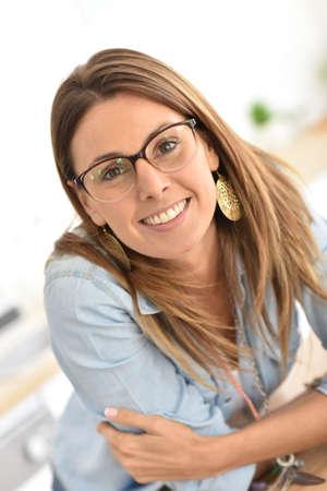 eyewear: Portrait of beautiful young woman with eyeglasses