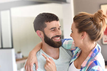 each: Cheerful hipster couple embracing each other Stock Photo