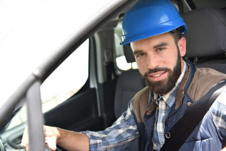 beard man: Technician sitting in vehicle