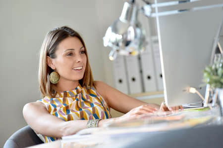 officeworker: Portrait of beautiful woman at work Stock Photo