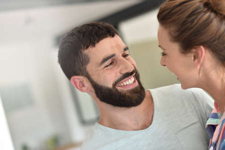 each other: Cheerful hipster couple embracing each other Stock Photo