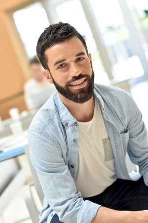 happy workers: Portrait of trendy businessman in meeting room