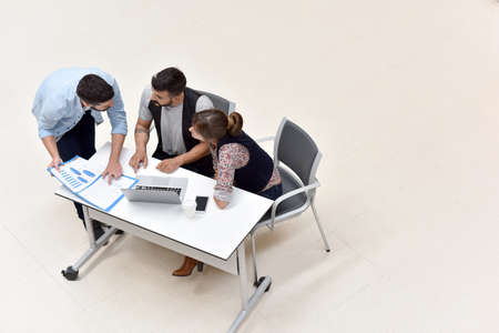 computer isolated: Upper view of business people meeting around table