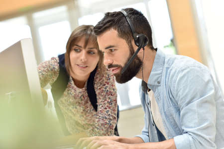 telemarketing: Telemarketing people working together in office