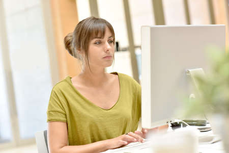 officeworker: Portrait of office worker in front of desktop