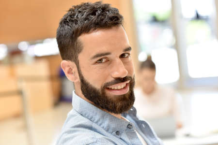 man with beard: Portrait of trendy businessman in meeting room