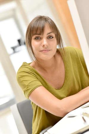 thirties: Portrait of office worker in front of desktop