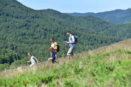 Family of four hiking in the mountain Stock Photo