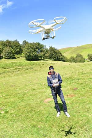 handling: Man handling drone in nature