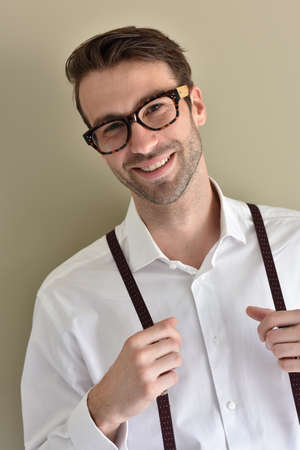 Stylish guy with eyeglasses and suspenders Stock Photo